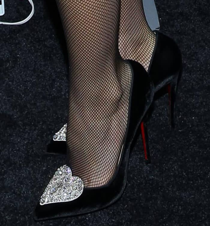 Gwyneth Paltrow shows off her feet in Christian Louboutin pumps