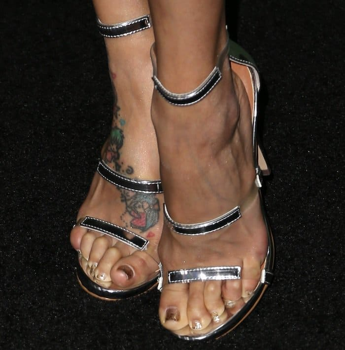 """Jeannie Mai showing off her bare feet in Tamara Mellon """"Frontline"""" sandals"""