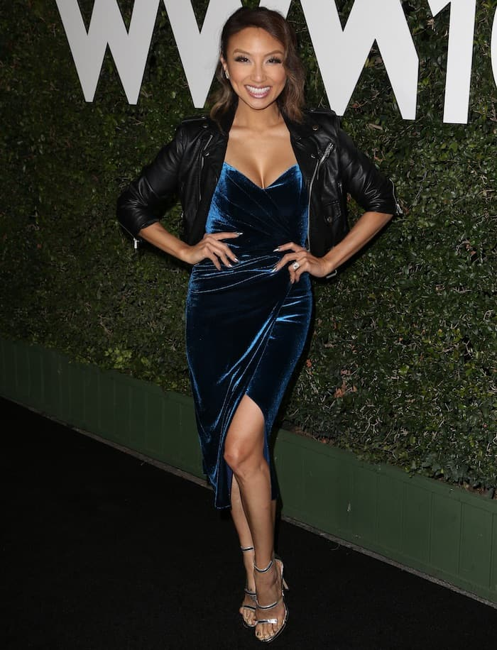Jeannie Mai in a green velvet dress that flaunted her toned legs