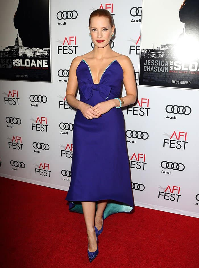 Jessica Chastain in a blue-purple Prada dress with a low-cut sweetheart neckline