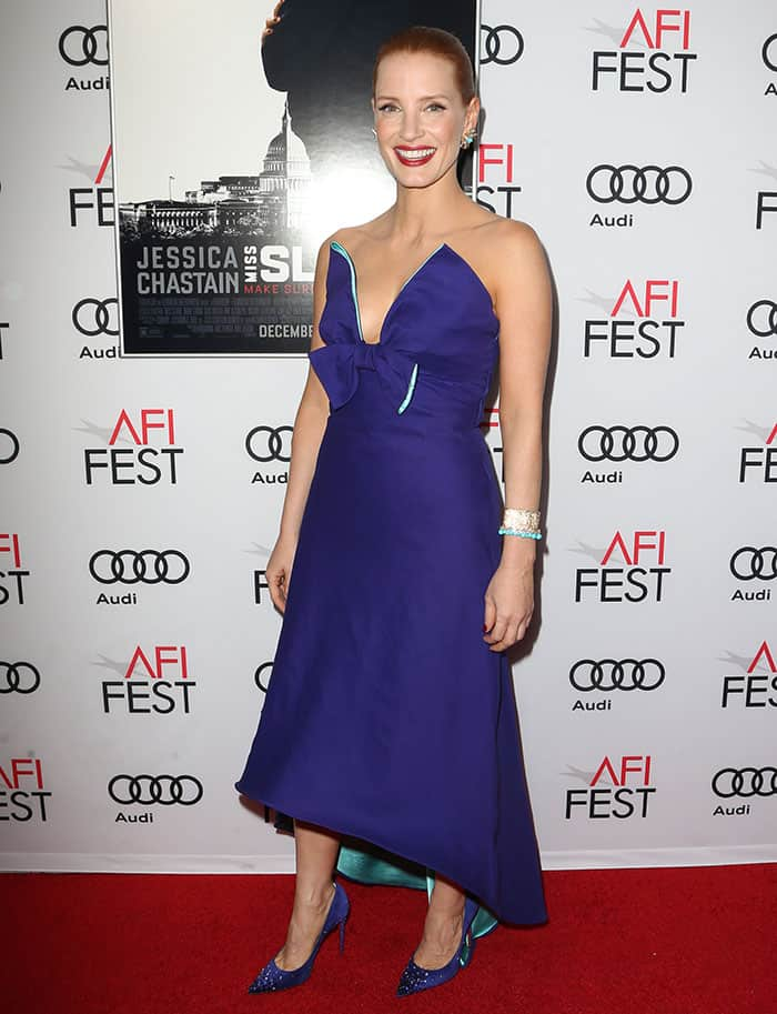 Jessica Chastain in a blue-purple Prada dress featuring a low-cut sweetheart neckline and a bow detail below the sternum