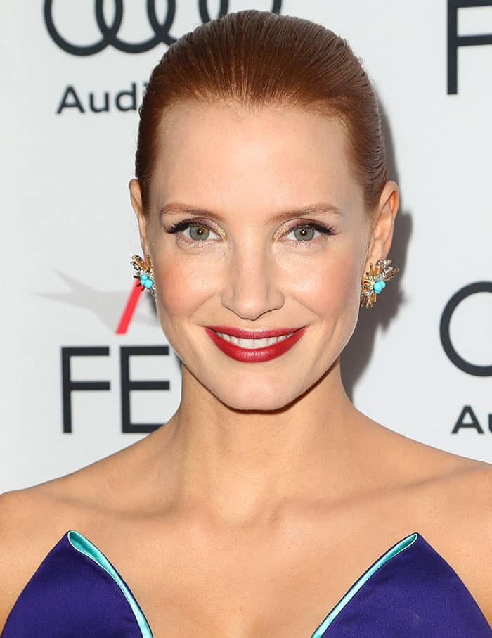 Jessica Chastain was flawlessly made-up, as usual, with her hair styled in a slicked back updo