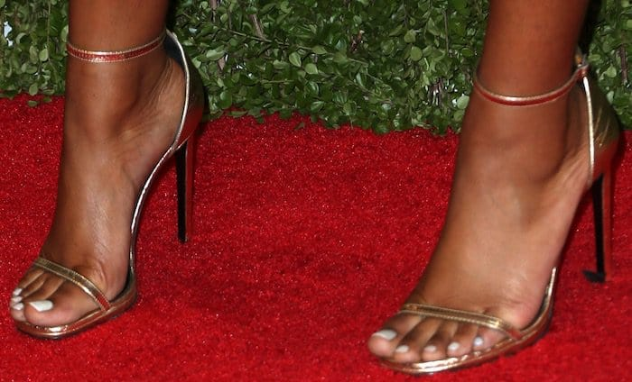 Keke Palmer displays her sexy toes in gold ankle-strap heels