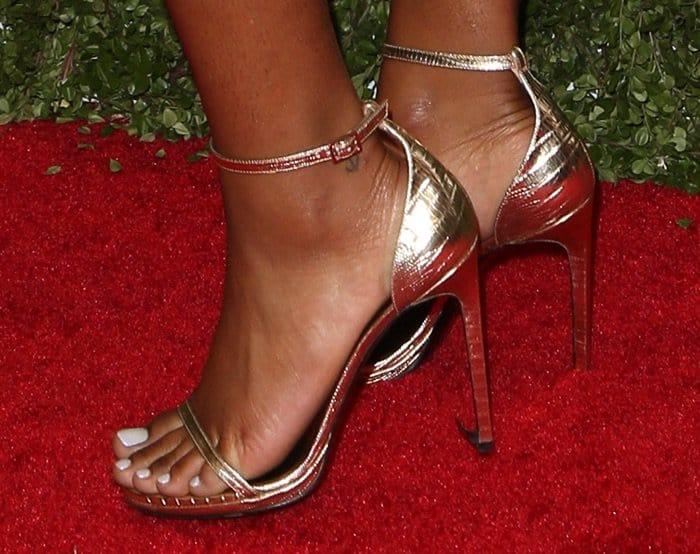 "Keke Palmer shows off her feet in Saint Laurent ""Jane"" ankle-strap sandals in gold"