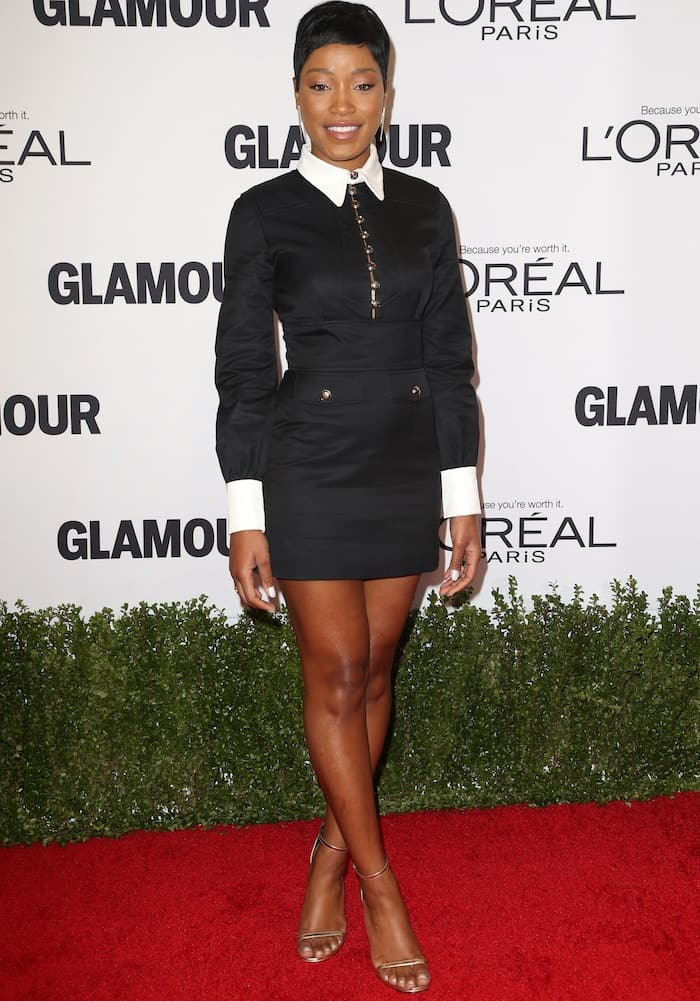 Keke Palmer's long-sleeve dress features black and white buttons