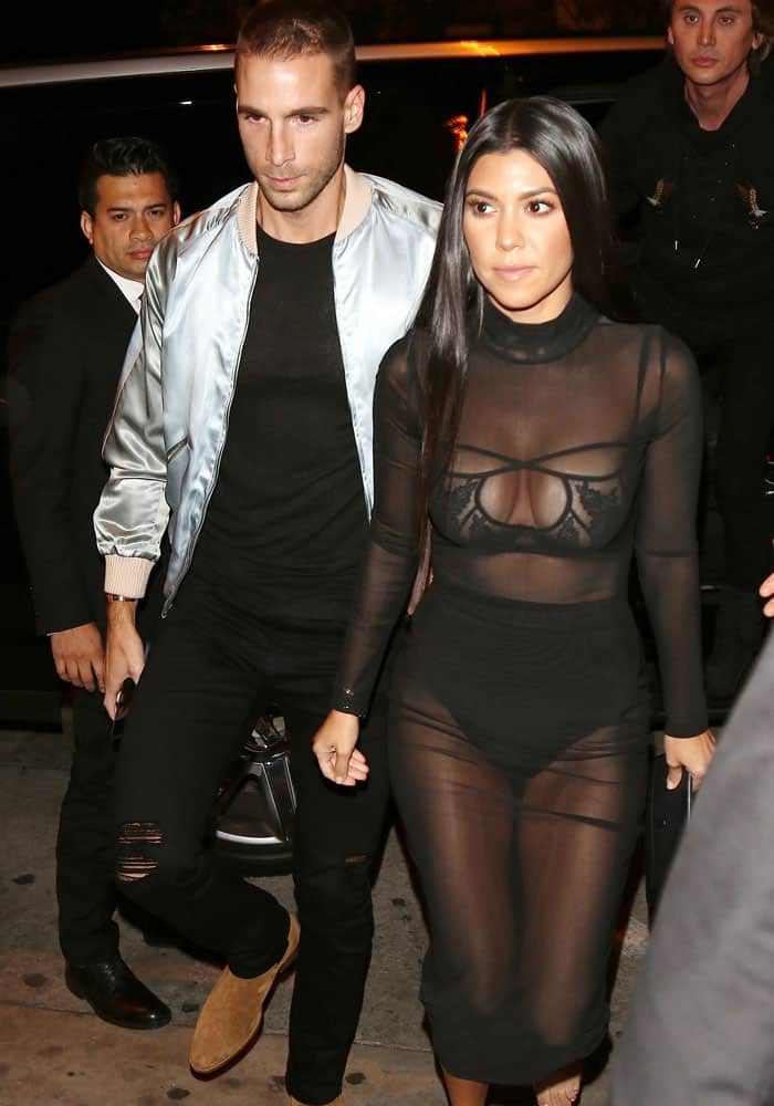 Kourtney pictured arriving at Catch restaurant with her mystery man,Simon Huck