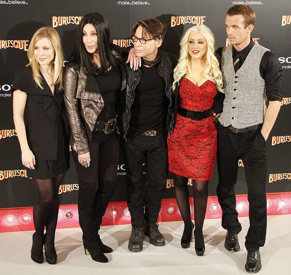 Actresses Kristen Bell, Cher, director Steven Antin, Christina Aguilera and actor Cam Gigandet photocall for the movie Burlesque