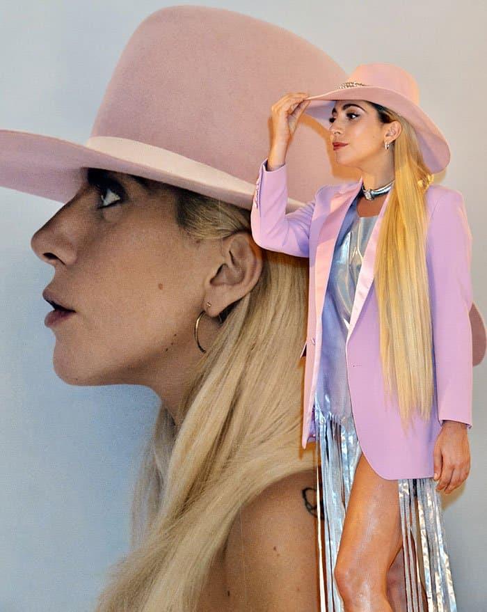 Lady Gaga in a silver dress and a bubblegum pink blazer
