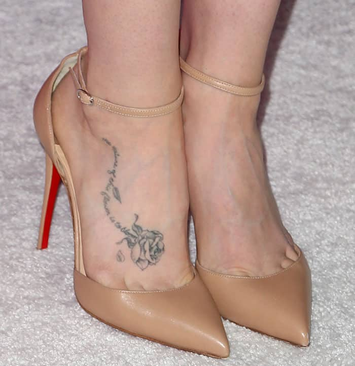Lily Collins shows off her floral foot tattoo in Christian Louboutin pumps
