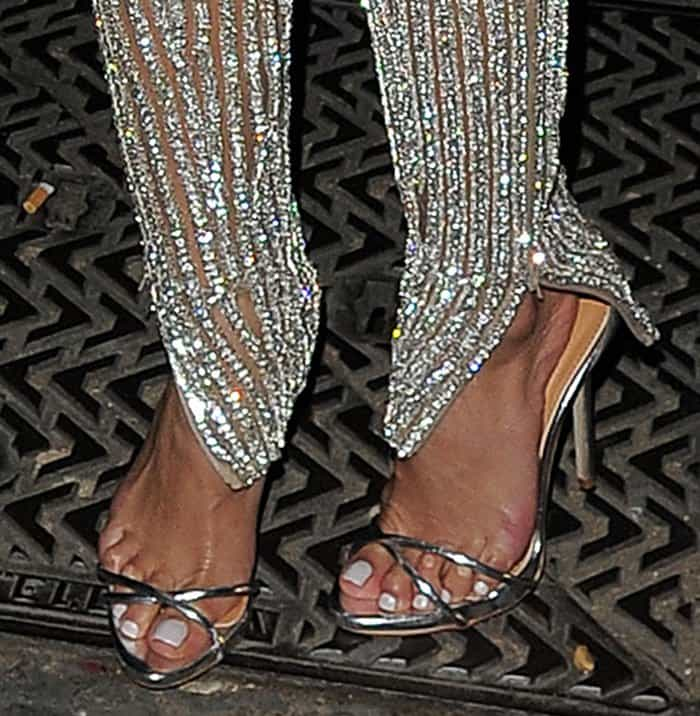 Nicole Scherzinger shows off the corns she has from wearing uncomfortable shoes
