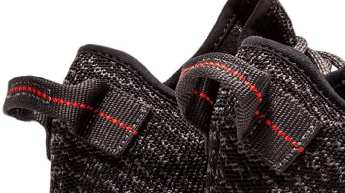 The heel of a Yeezy shoe is filled with intricate details