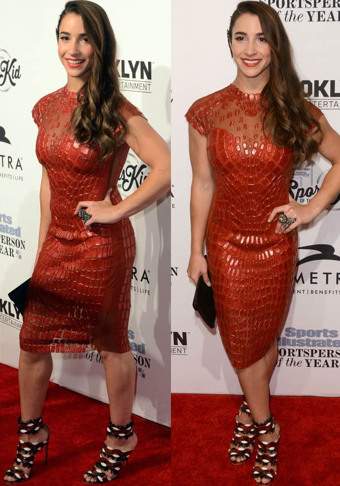 Gymnast Aly Raisman flaunted her legs in a red form-fitting red metallic dress