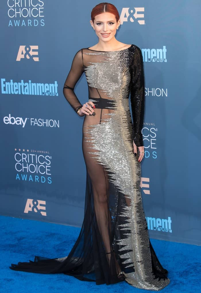 Bella Thorne styled the long-sleeved gown with a pair of 'Nudist' ankle-strap sandals from Stuart Weitzman