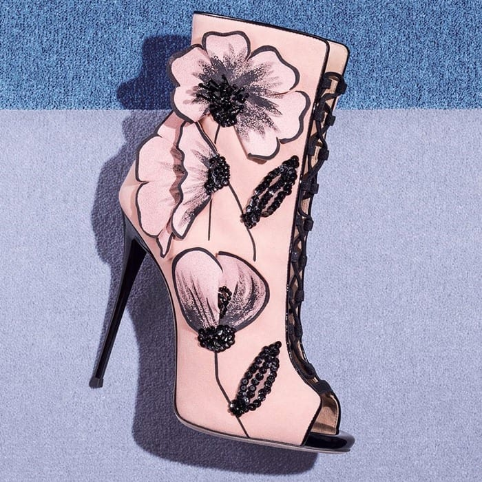 Pink suede 'June' boots featuring a flower motif with black crystals and paillettes