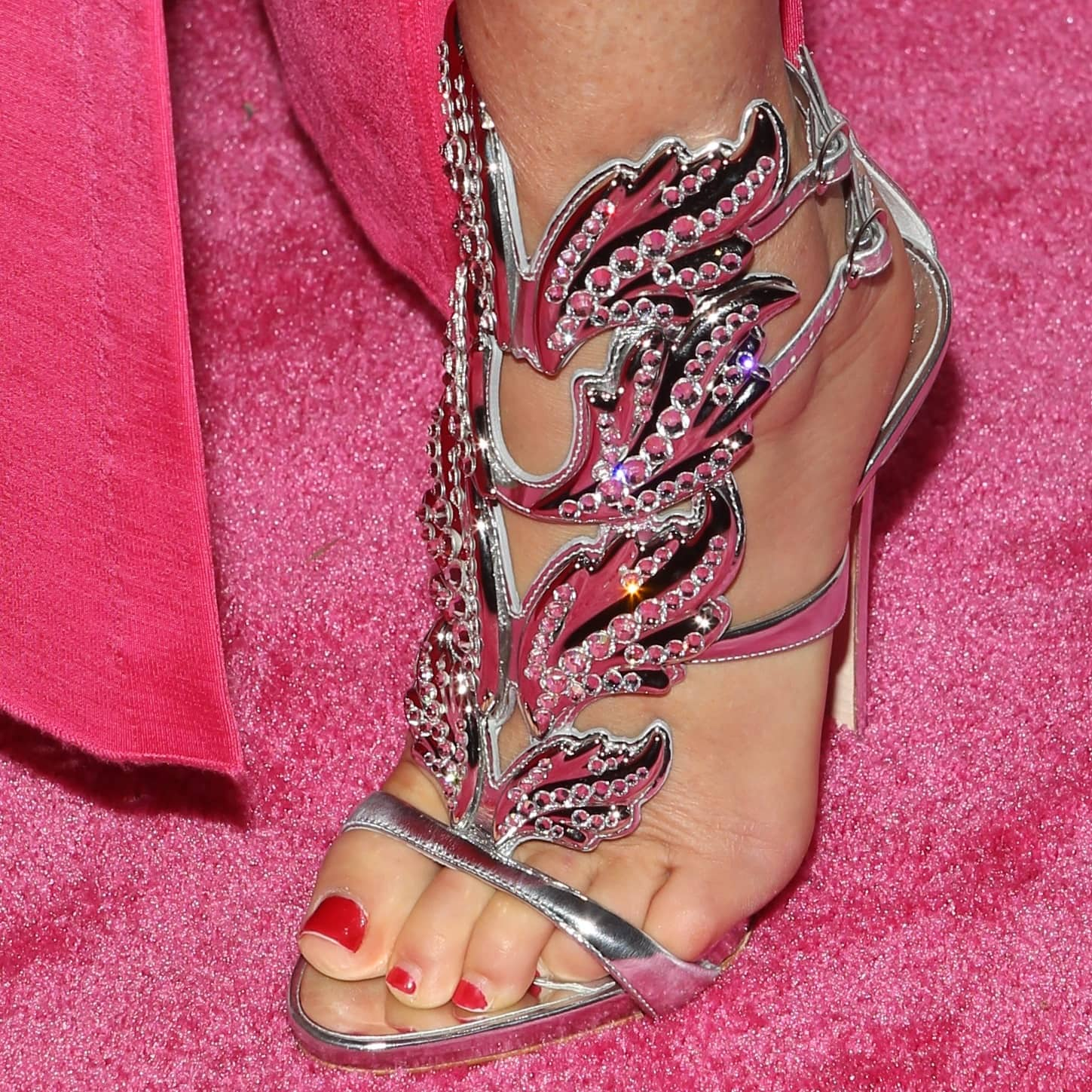 Dee Ocleppo Hilfiger shows off her feet in silver Cruel crystal sandal with crystal wing embellishment