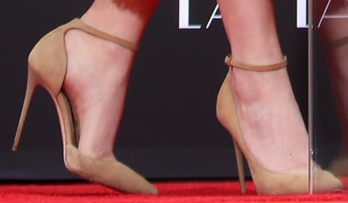 Emma Stone wearingLucy d'Orsay pumps in beige suede