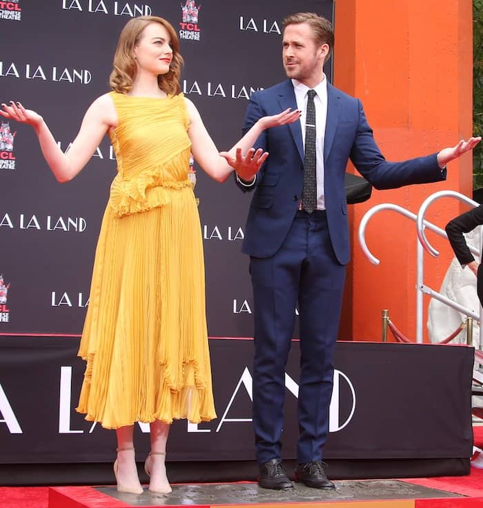 Emma Stone and Ryan Gosling cement their hand and footprints at the TCL Chinese Theater in Hollywood on December 6, 2016