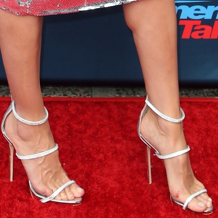 Heidi Klum's feet in heels with crystal embellished straps