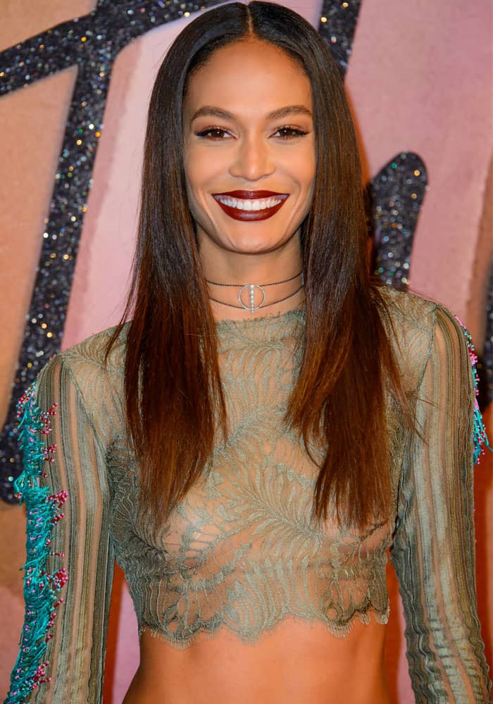Joan Smalls arrived at the fashion year-ender's red carpet looking stunning in a cropped see-through ensemble