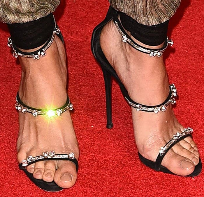 "Joan gives her feet a little sparkle with the Giuseppe Zanotti ""Harmony"" sandals"