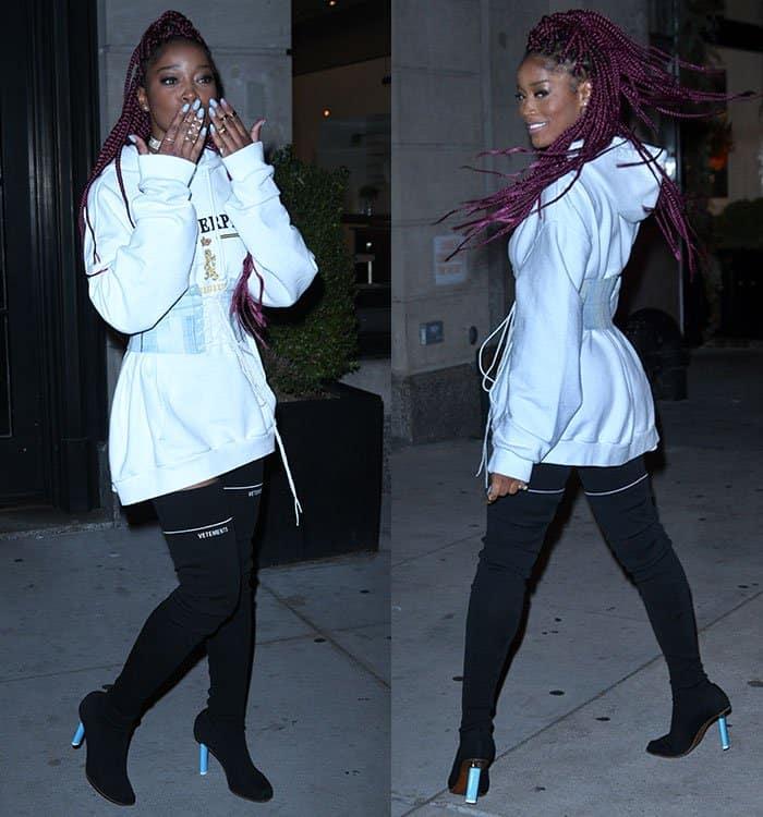 keke-palmer-white-hoodie-lace-up-belt-black-boots