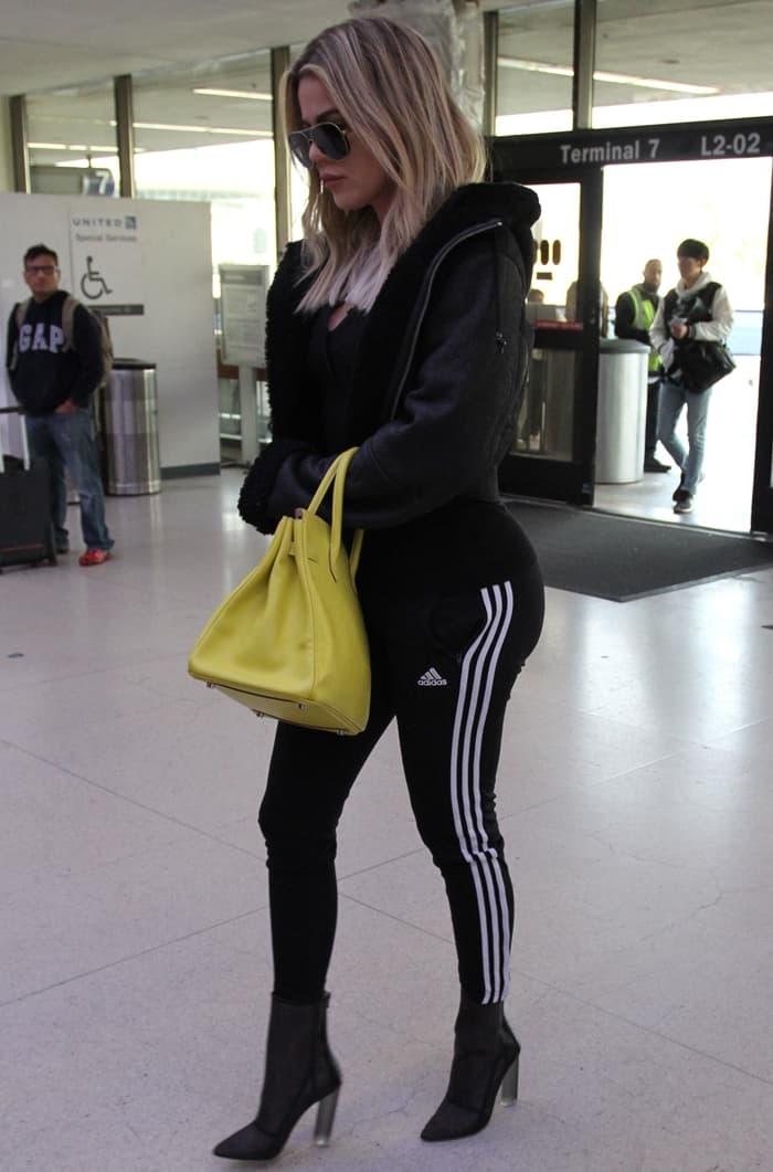 Khloe Kardashian wearing Adidas Originals 'Supergirl' track pants