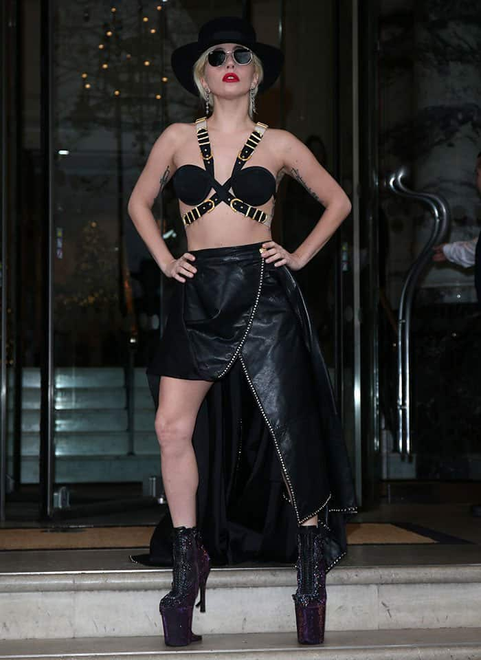 Lady Gaga leaves her London hotel wearing a harness bra and gothic purple boots on December 6, 2016