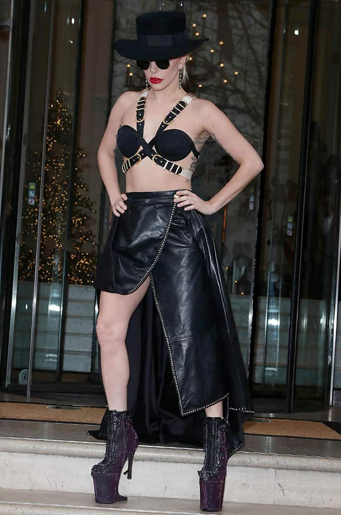 Lady Gaga flaunts her legs in a revealing top paired with an asymmetrical leather skirt