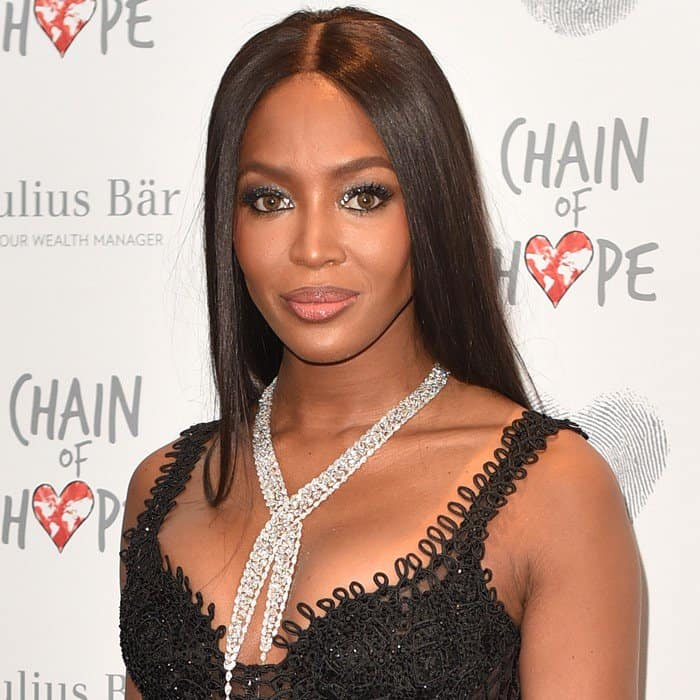 Naomi showed off her figure in a sleeveless black ball gown by Versace