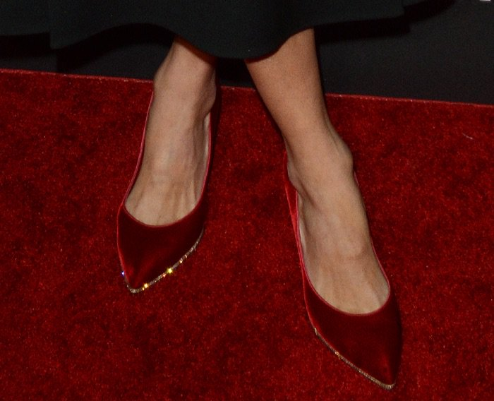Nicky Hilton shows off her sexy feet inred velvet pumps from Rene Caovilla