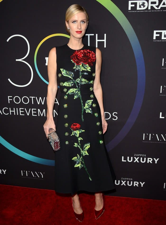 Nicky Hilton donned a midi dress with a high neckline that featured floral embroidery