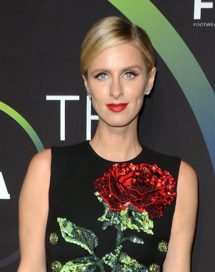 Nicky Hilton goes for red lips and a sleek updo for the 30th Footwear News Achievement Awards
