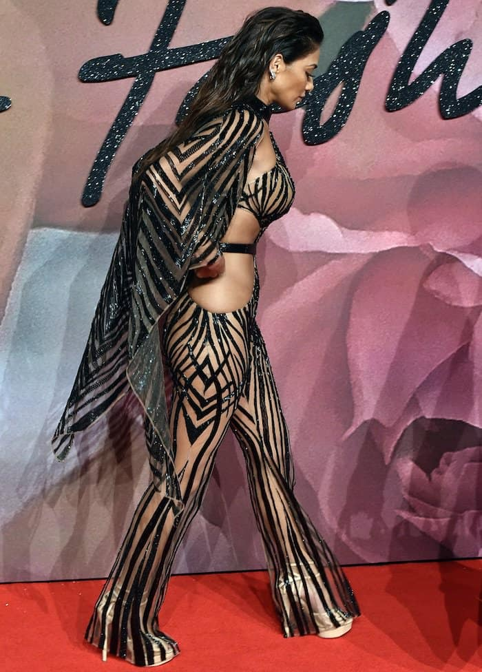 Nicole Scherzinger in a sheer Julien Macdonald jumpsuit at The Fashion Awards 2016 on December 5, 2016, at the Royal Albert Hall in London