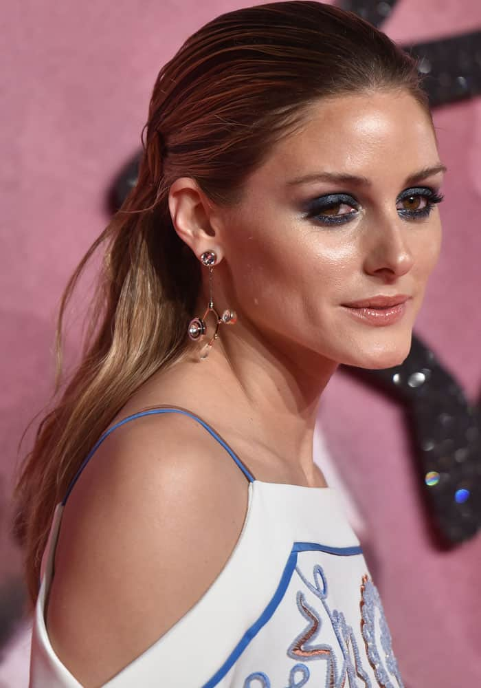 Olivia Palermo wears Atelier Swarovski by Peter Pilotto Arbol long pierced earrings at The Fashion Awards 2016