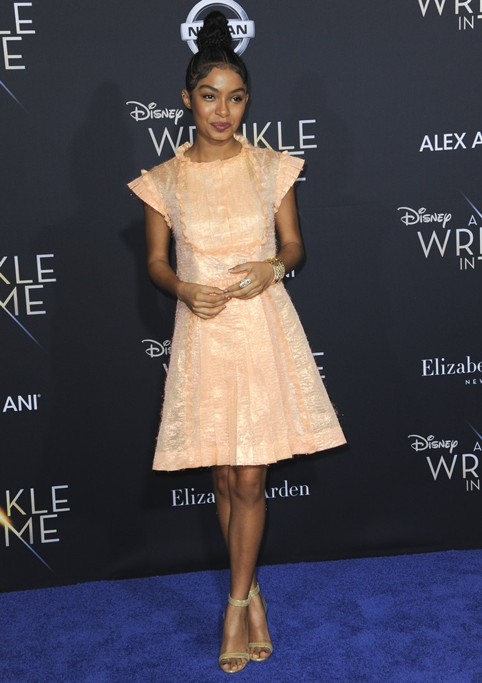 Yara Shahidi parades her sexy legs in a pleated peach Chanel Spring 2018 dress on the blue carpet