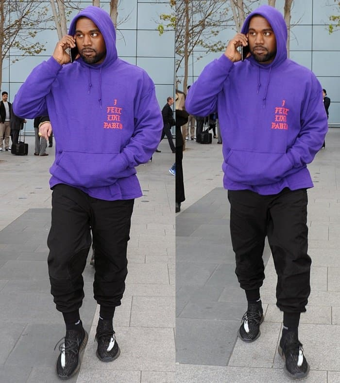 Kanye West wearing Yeezy Boost sneakers at Heathrow Airport in London on April 10, 2016