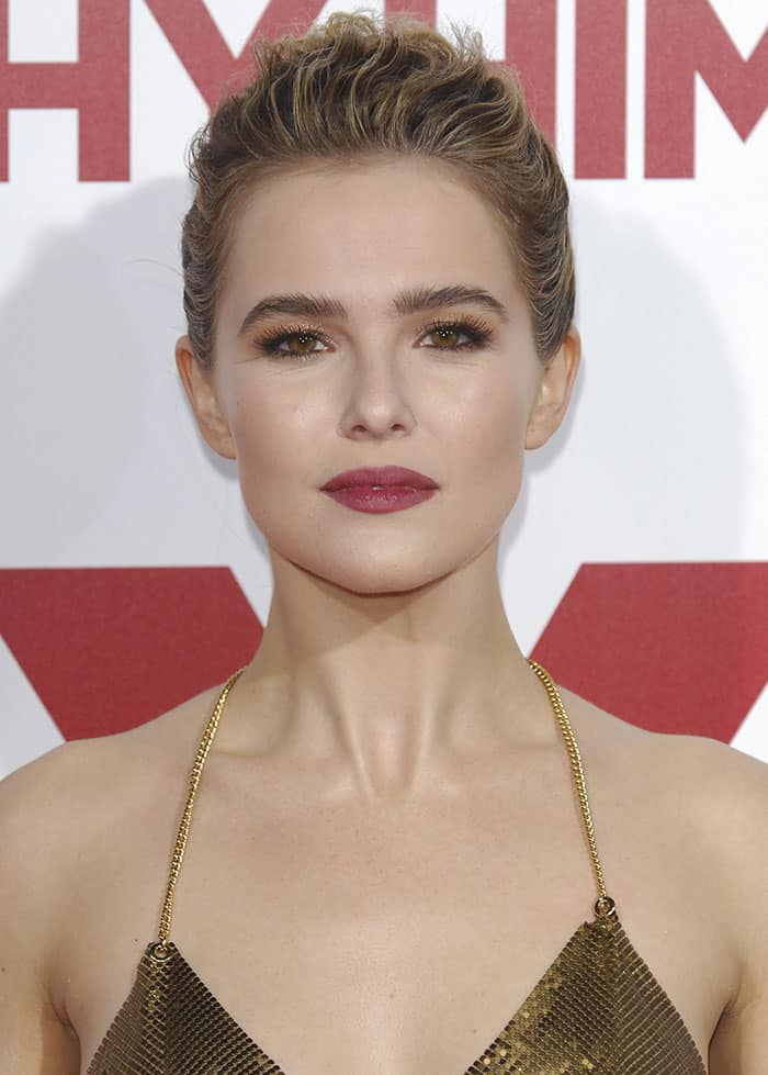 Zoey Deutch's tresses were styled in a chic braided updo, while her makeup looked gorgeous with subtle smoky eyeshadow and magenta lipstick