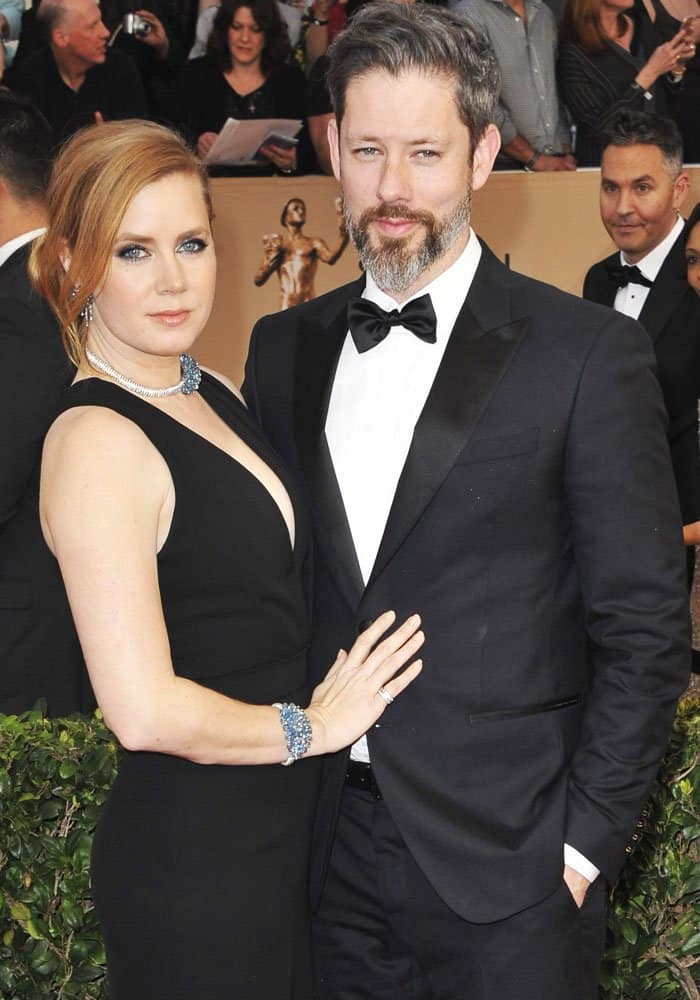 Amy Adams cuddles up to her husband, Darren Le Gallo