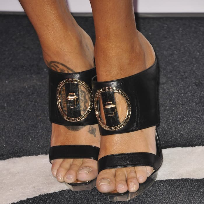 Eiza Gonzalez shows off her feet in black sandals from Versace