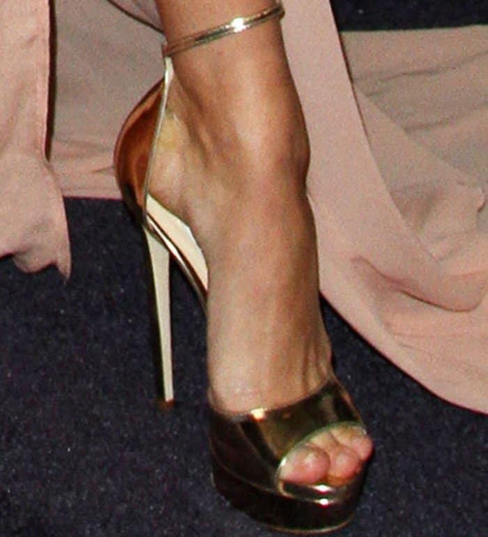 Hailey Baldwin shows off her feet in Jimmy Choo platform sandals