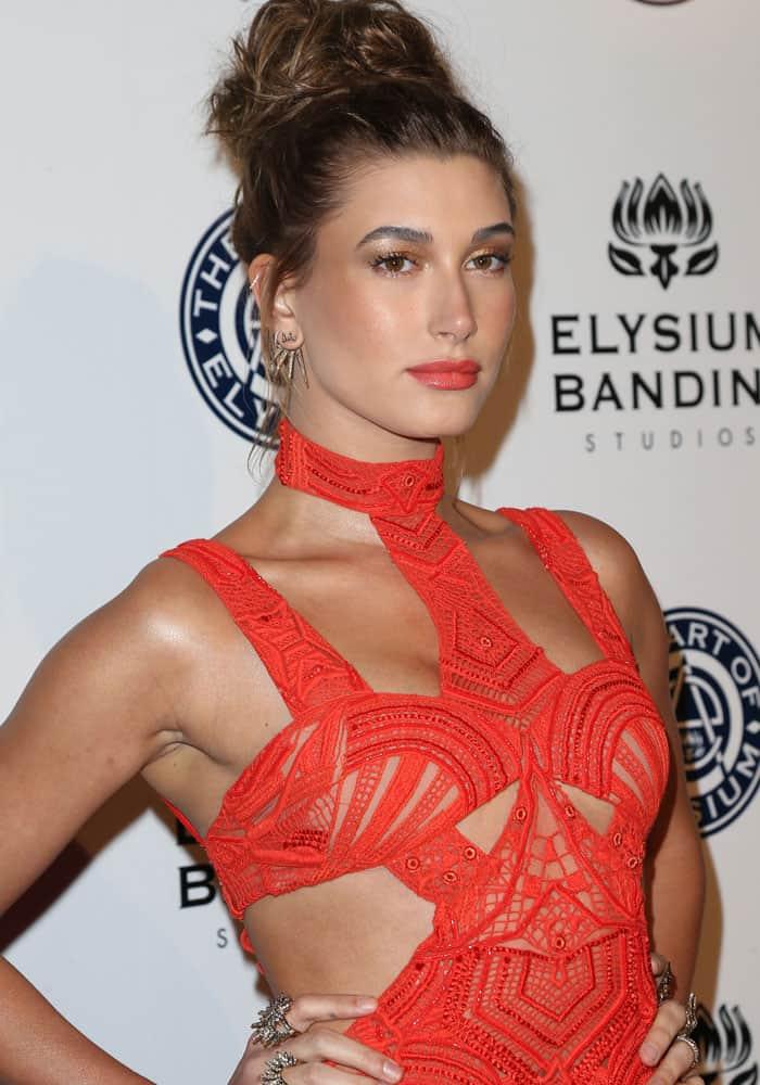 Hailey Baldwin wears a tangerine dress