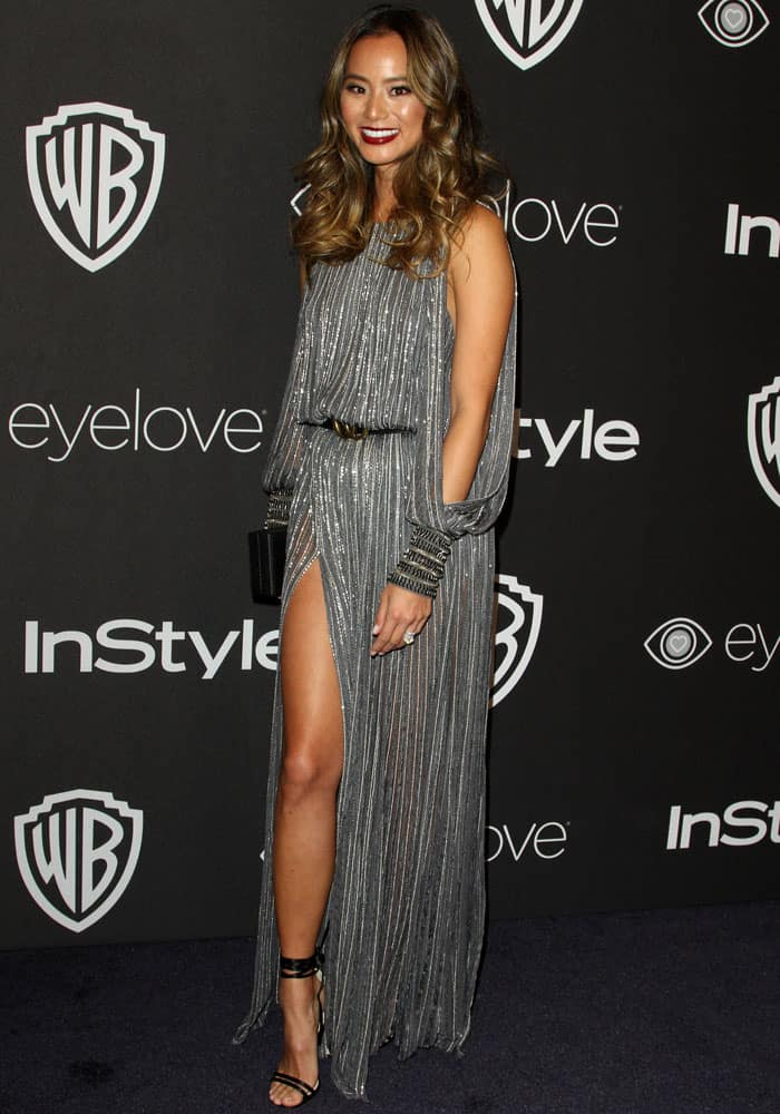 Jamie Chung flashes some leg in a gray Amanda Wakeley dress