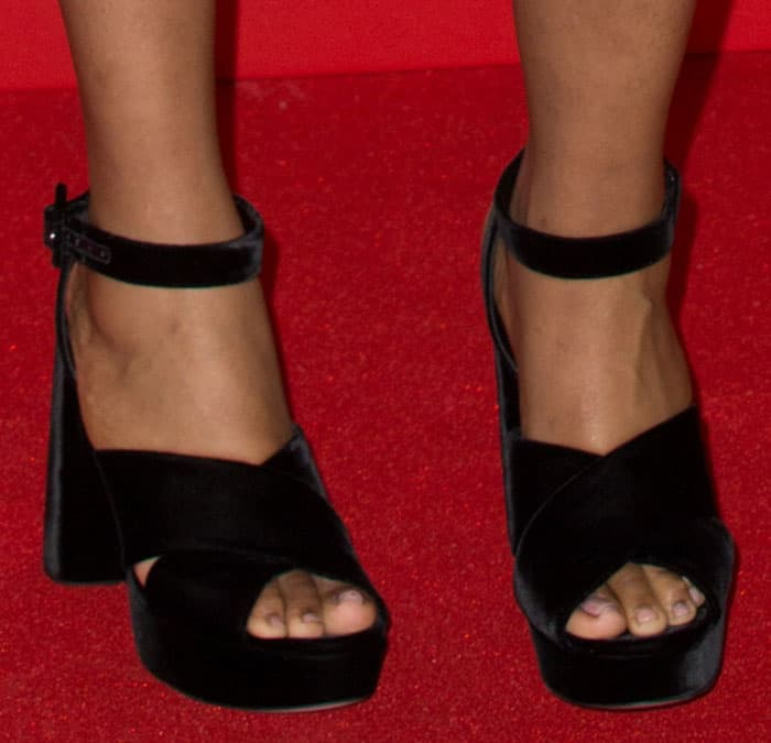 ea488052800 These black velvet sandals are by Miu Miu. They feature wide crisscross  vamps