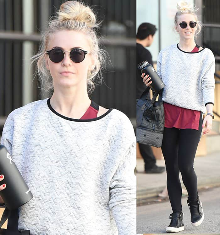 Julianne Hough wears a gray sweater over a maroon tank top