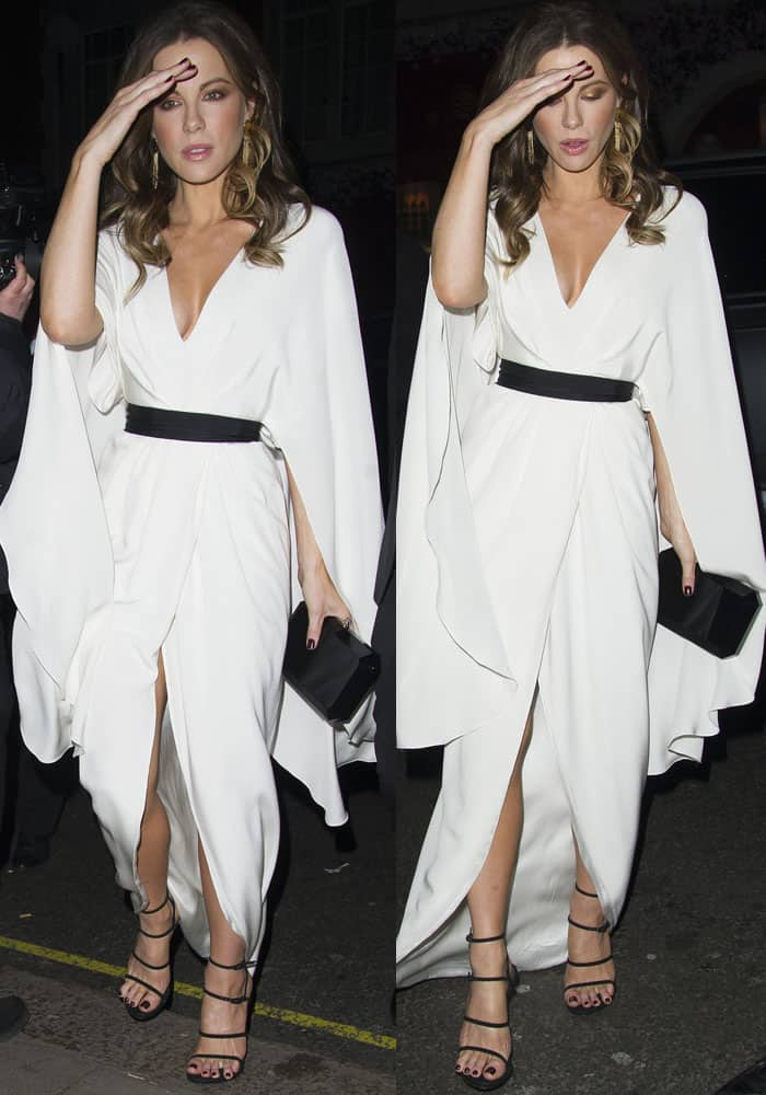 Kate stepped out in one of her signature white looks, this time in a breathtaking faux wrap dress from Christian Siriano's Spring 2017 collection