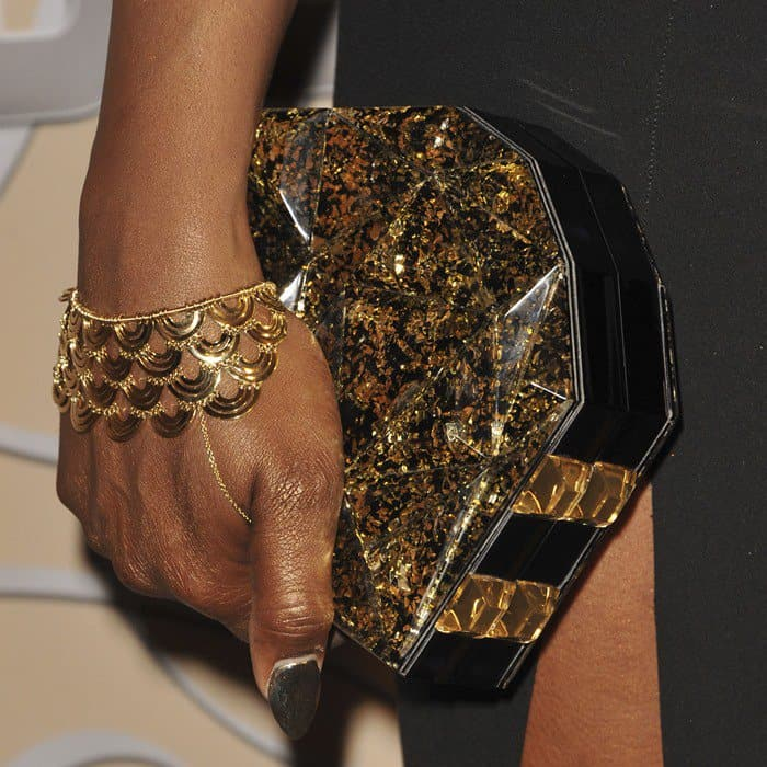 Laverne Cox showed off her Cadar 'Water Duplex' bracelet and the iconic Genny clutch