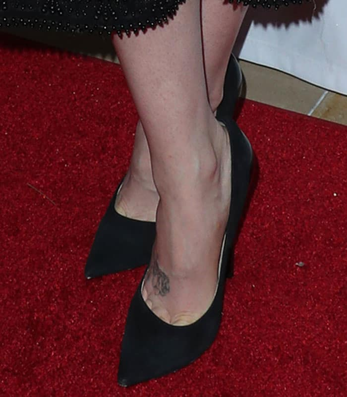 Lily Collins in Jimmy Choo pumps