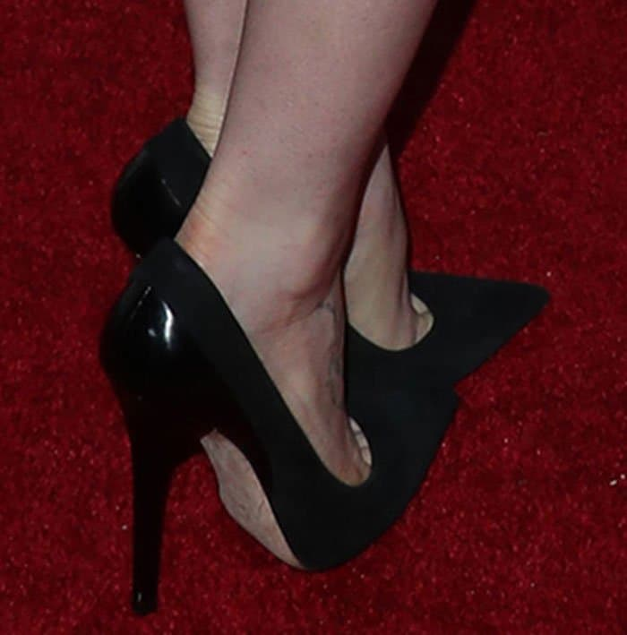 Lily Collins in Jimmy Choo pointed toe pumps