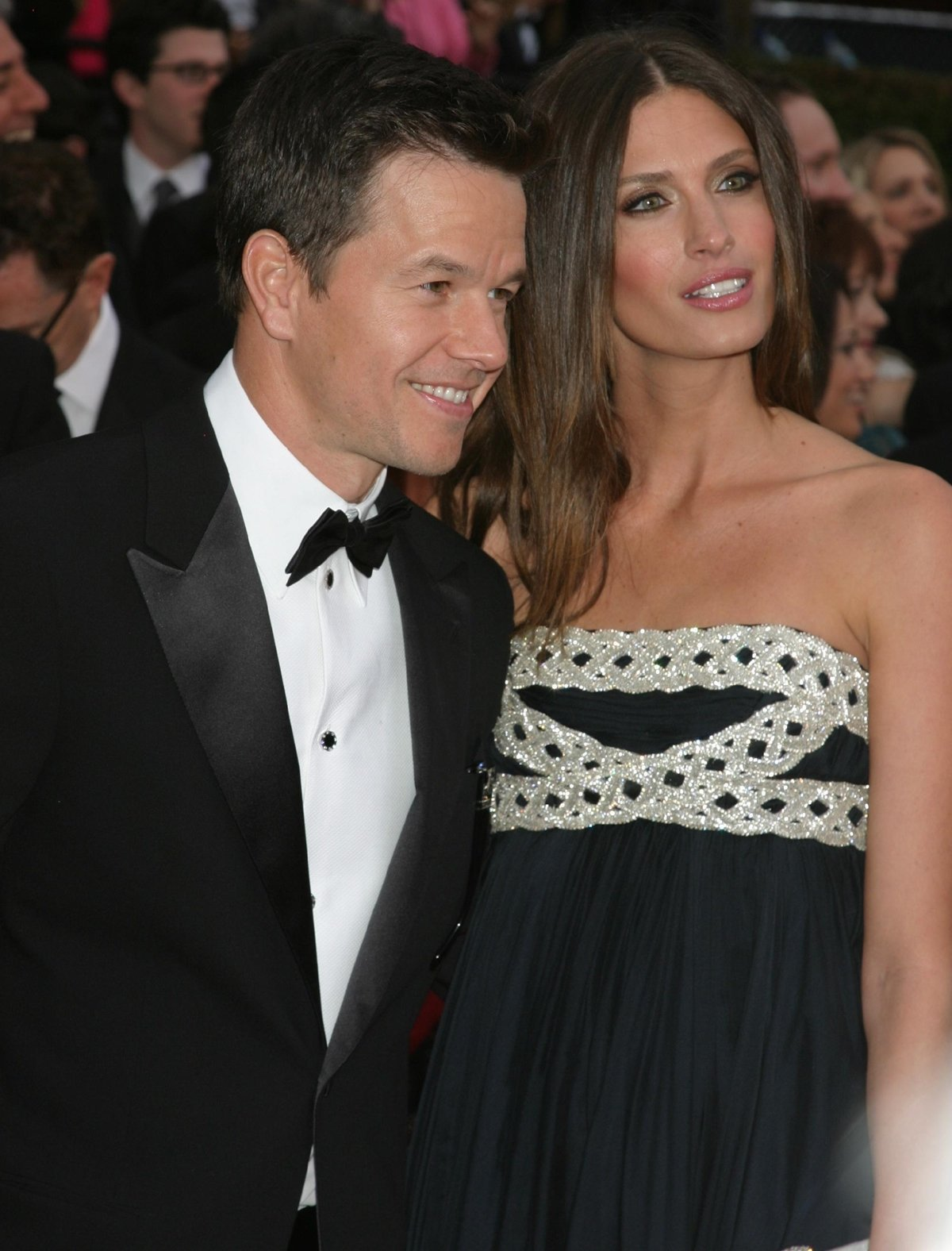 Actor Mark Wahlberg in a Giorgio Armani tuxedo and his wife Rhea Durham in a Marchesa dress at the 79th Annual Academy Awards
