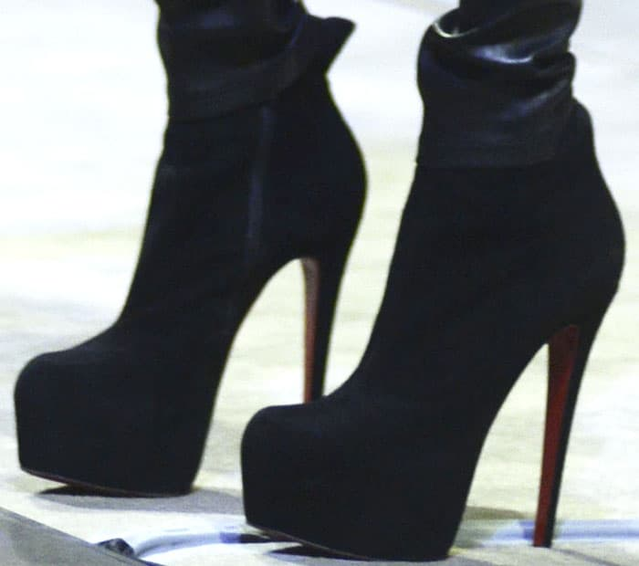 """Michelle towers on stage in the Christian Louboutin """"Daf Booty"""" suede ankle boots"""